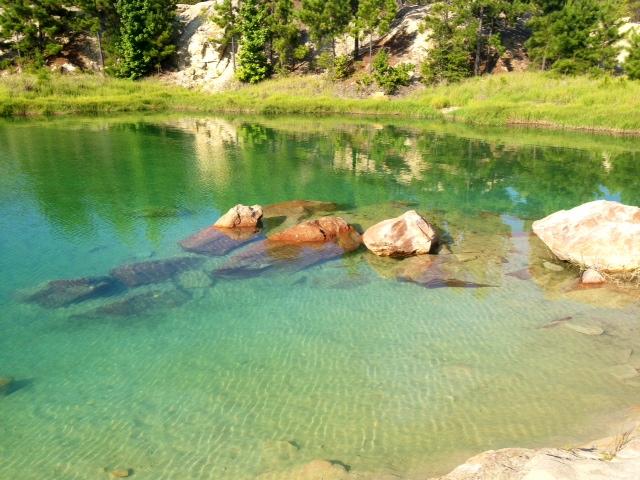 happy wife scuba dive blue lagoon water rocks